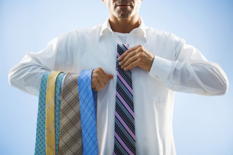 Businessman Selecting Tie
