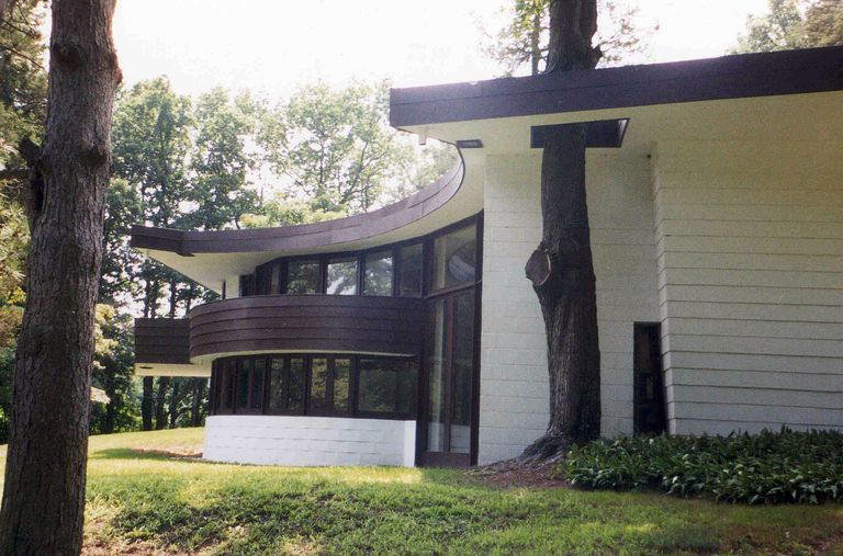 Mid-century Modern Curved Hemicycle Home, White with Brown Trim and Accents, in a Wooded Lot