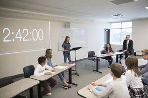 Middle school students in debate club in classroom