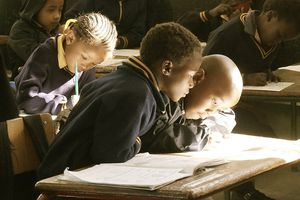 Students in a classroom working at their desks.