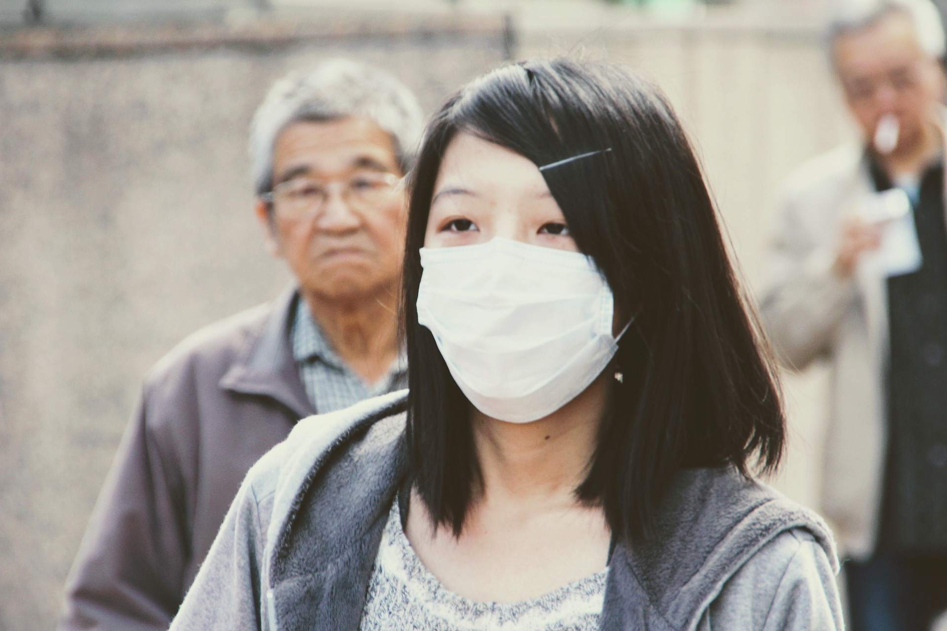 Young Asian woman wearing a protective face mask.