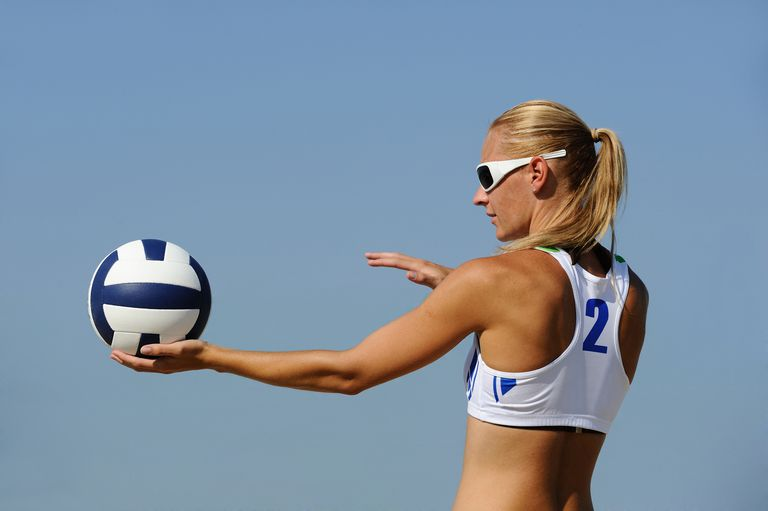 Woman serving volleyball