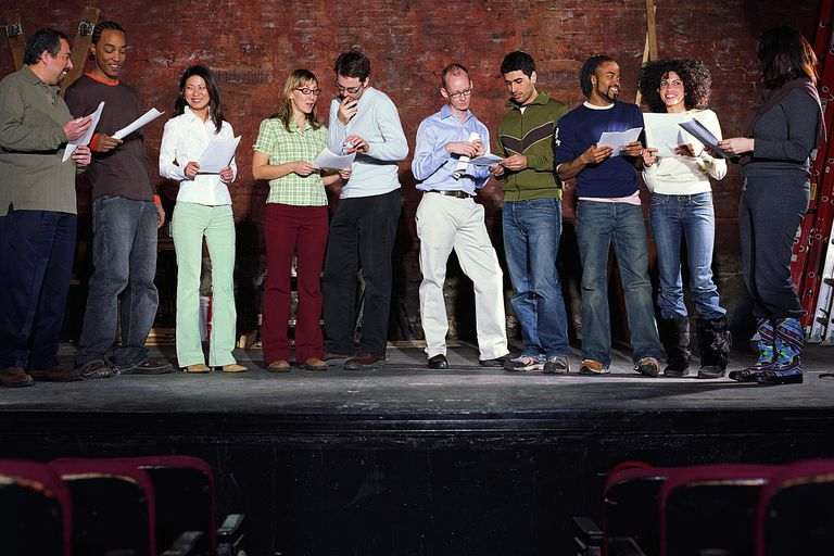 Group of people on stage in theater