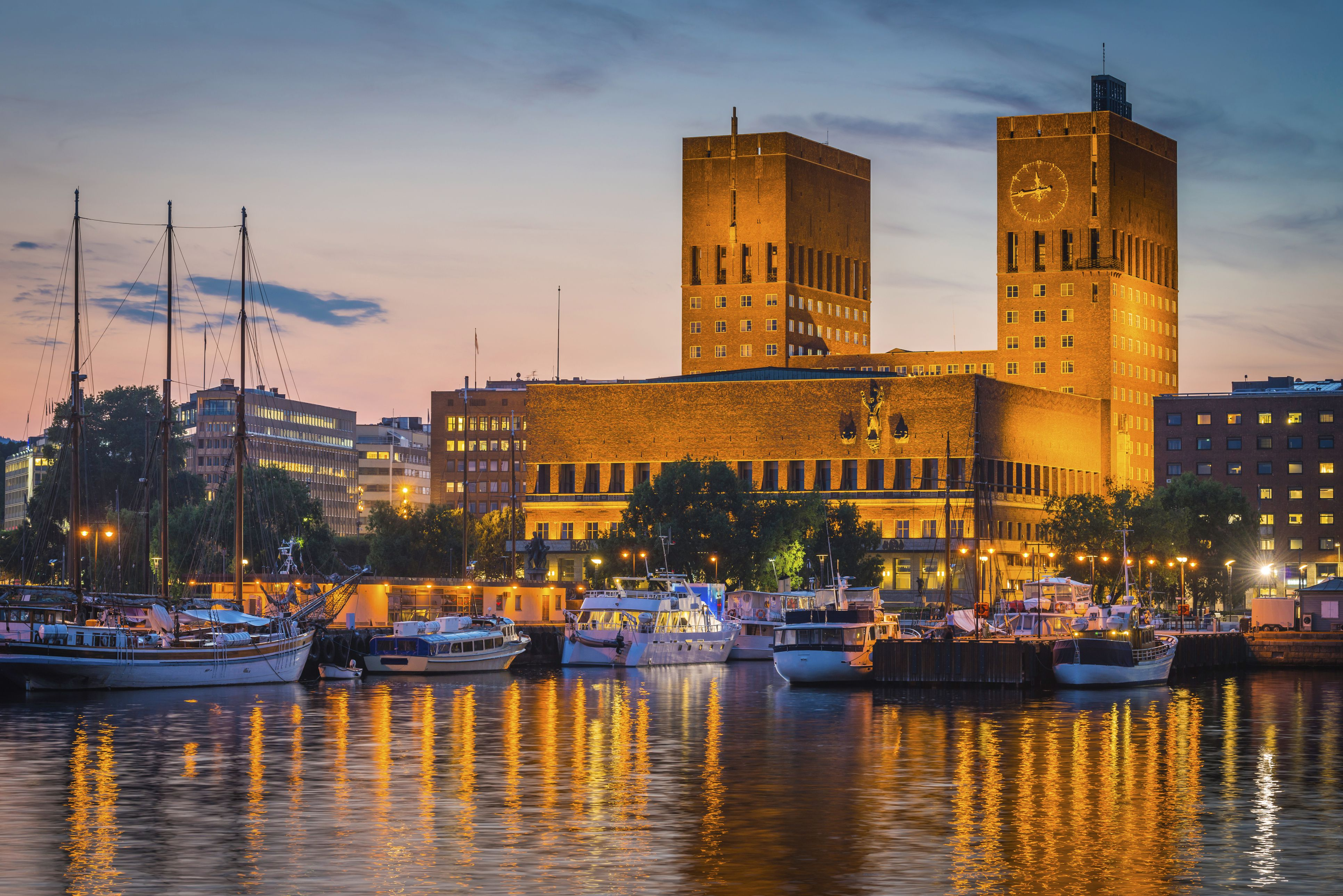 Towers of Oslo's City Hall, harbor view at sunset