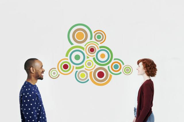 two people talking with colorful swirls between them