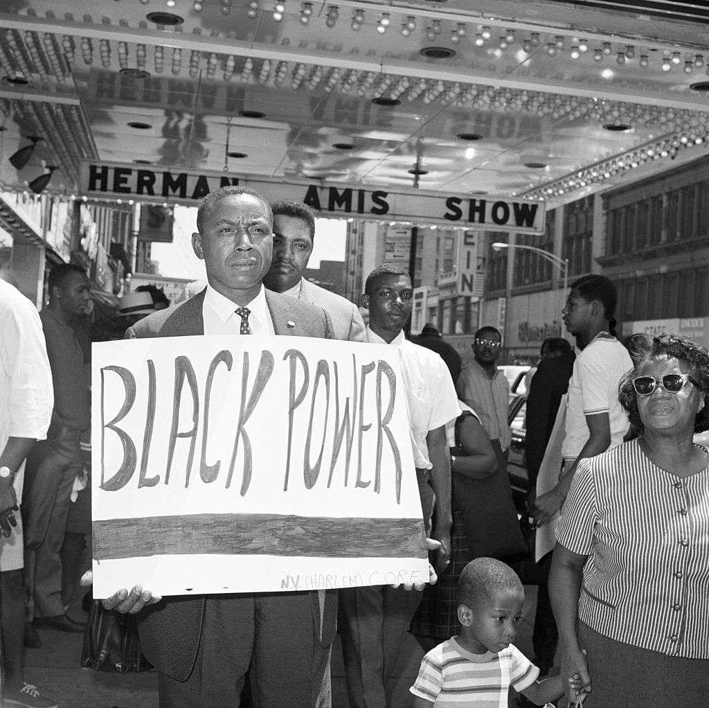 Floyd McKissick Holding Black Power Sign