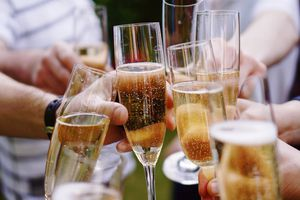 people clinking glasses with champagne