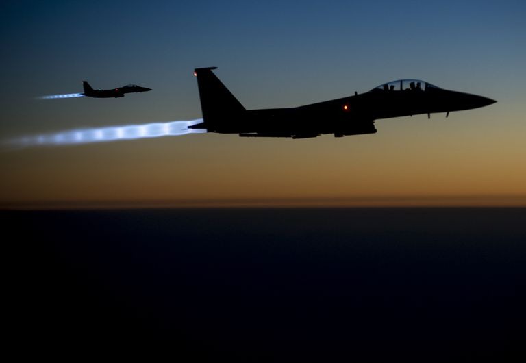 A pair of U.S. Air Force F-15E Strike Eagles fly over northern Iraq early in the morning of Sept. 23, 2014, after conducting airstrikes in Syria.