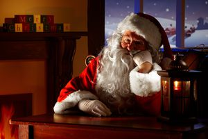 close up of bored Santa sitting in his grotto