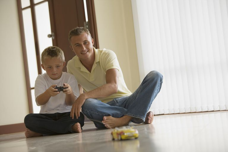 Father and son playing with RC toy car