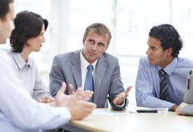 Taking the lead A group of executives havi...