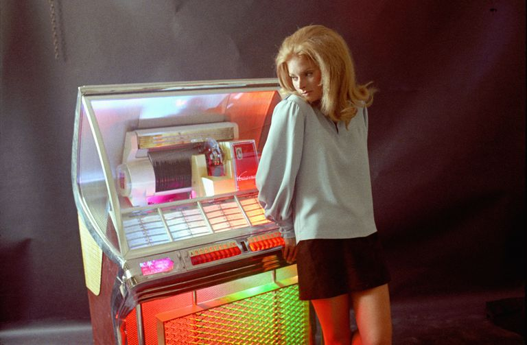 A list of important inventions and innovations a young woman stands in the glow of a multicolored juke box in the late 1960s getty imagesmichael ochs archives stringer publicscrutiny Choice Image