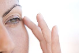 Extreme Close-up of Woman Touching Corner of her Eye