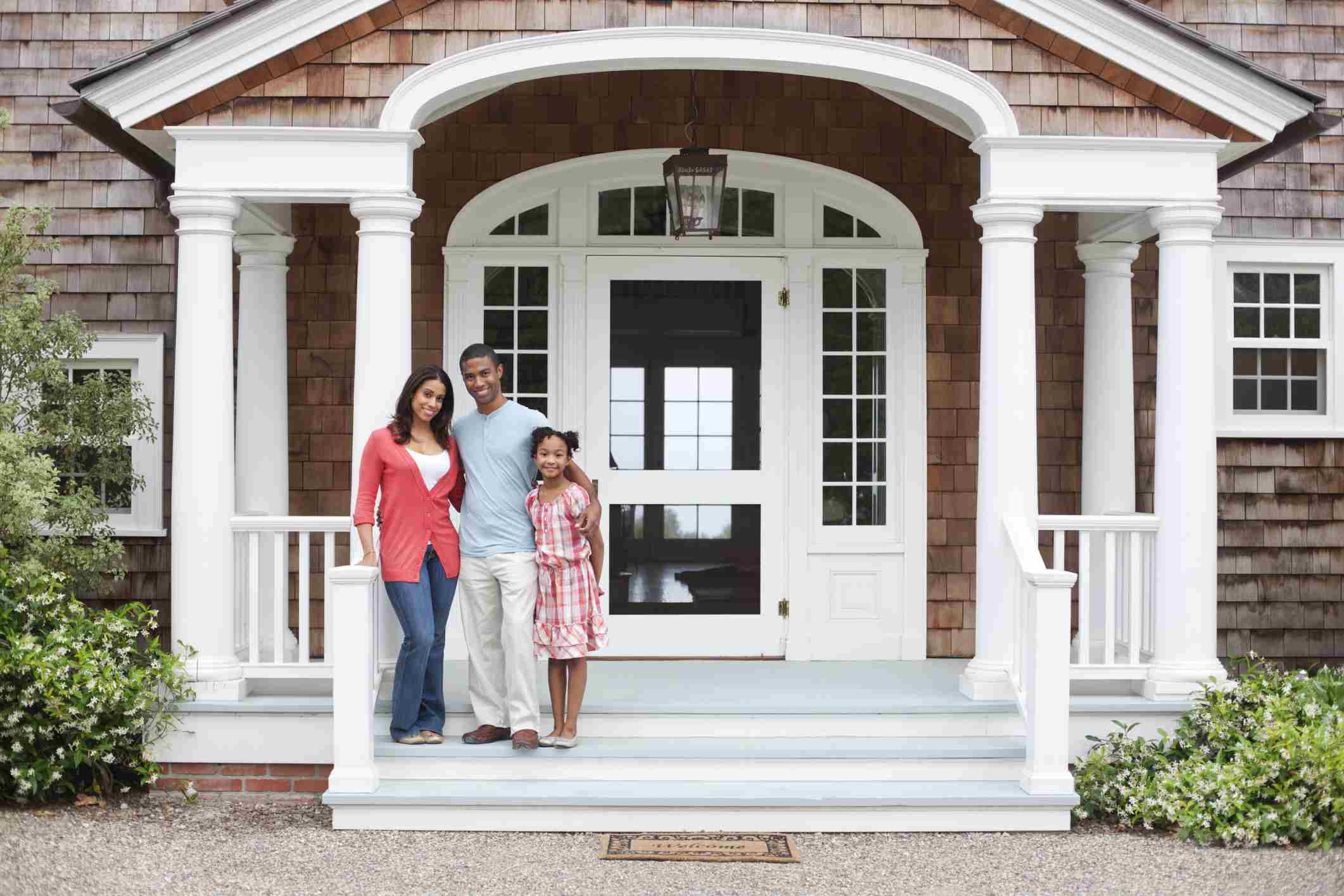 black family standing on the columned porch of their shingled house