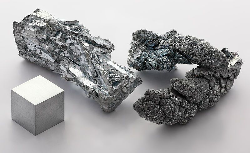Zinc or spelter is a silvery-gray metallic element.