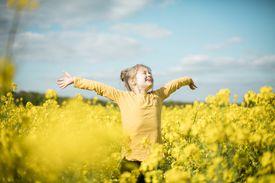 Carefree girl in field of flowers