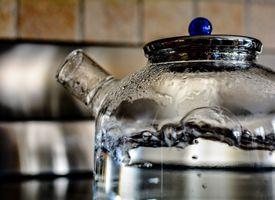 Water is a chemical with an extremely high heat capacity. It takes a lot of energy to raise its temperature.