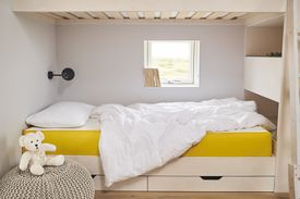Child's bedroom with a bed in the center.