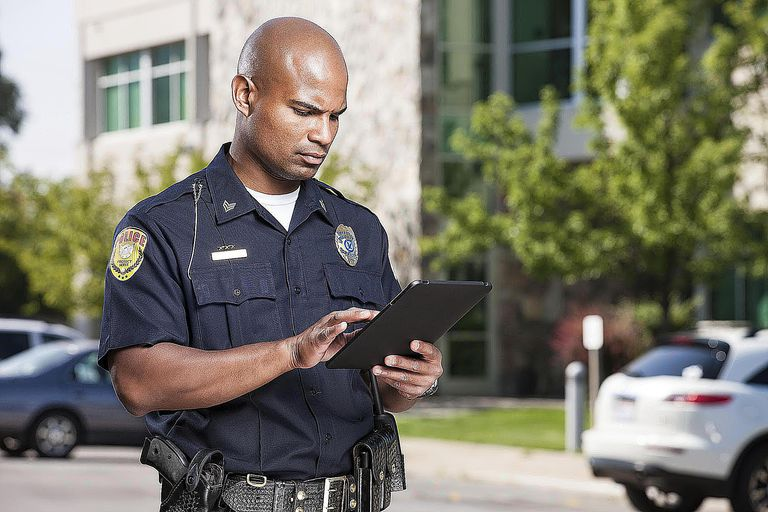 Police officer on duty, using ipad