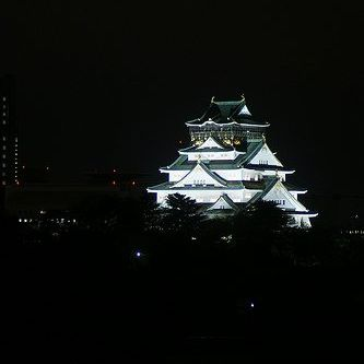 Osaka Castle seems to float above the city by night.