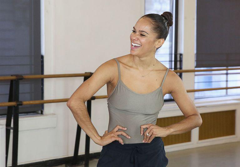 Ballerina Misty Copeland laughing in casual wear inside a ballet studio