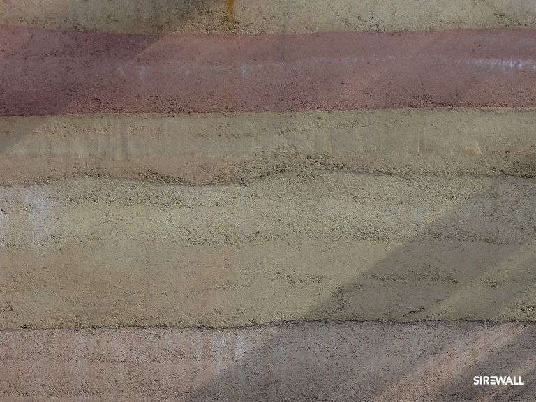 Detail of rammed earth textured layers at the Sirewall-built China Pavilion