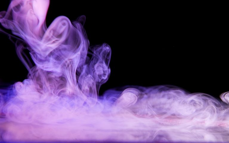 When you drop dry ice in water, it sublimates to form carbon dioxide gas. Place a colored light under the fog to produce a colored glow.