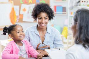 Parent and kid talk to a teacher