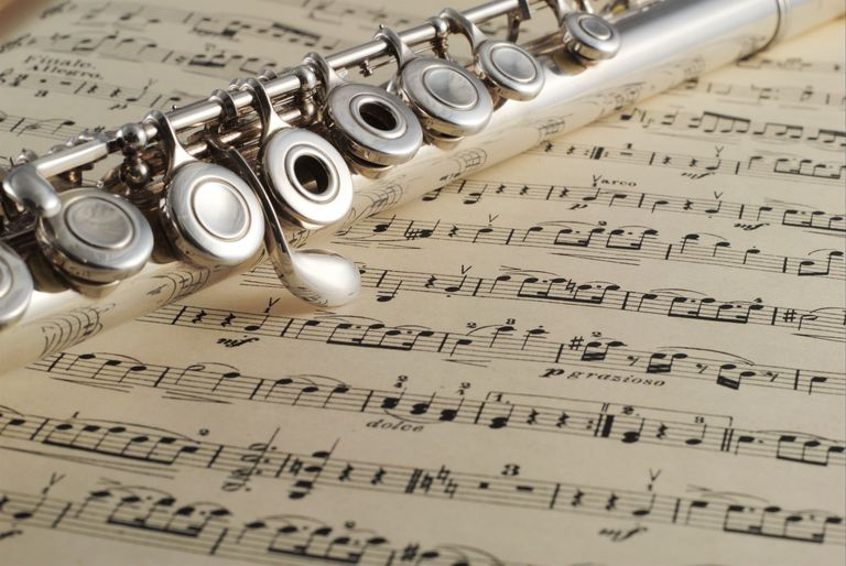 german flute on a music book, shallow depth of field