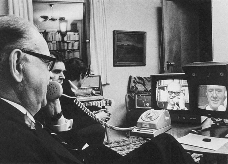 More details Swedish Prime Minister Tage Erlander using an Ericsson videophone to speak with Lennart Hyland, a popular TV show host (1969)