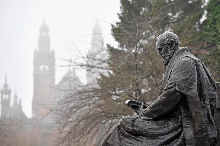 Frost-covered statue of Lord Kelvin in a wintery park