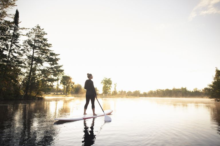 woman stand-up paddleboarding