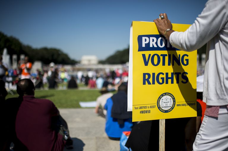 Protester holding sign demanding the protection of voting rights