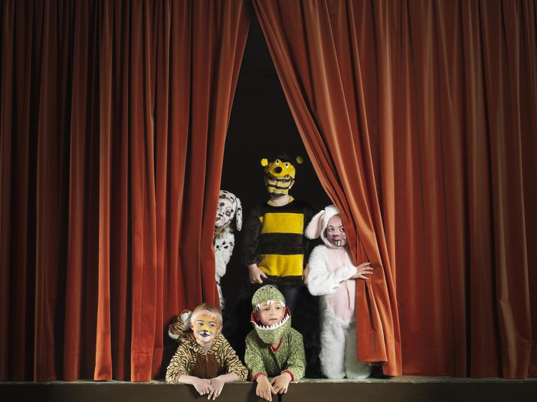 Children wearing animal costumes on stage, portrait