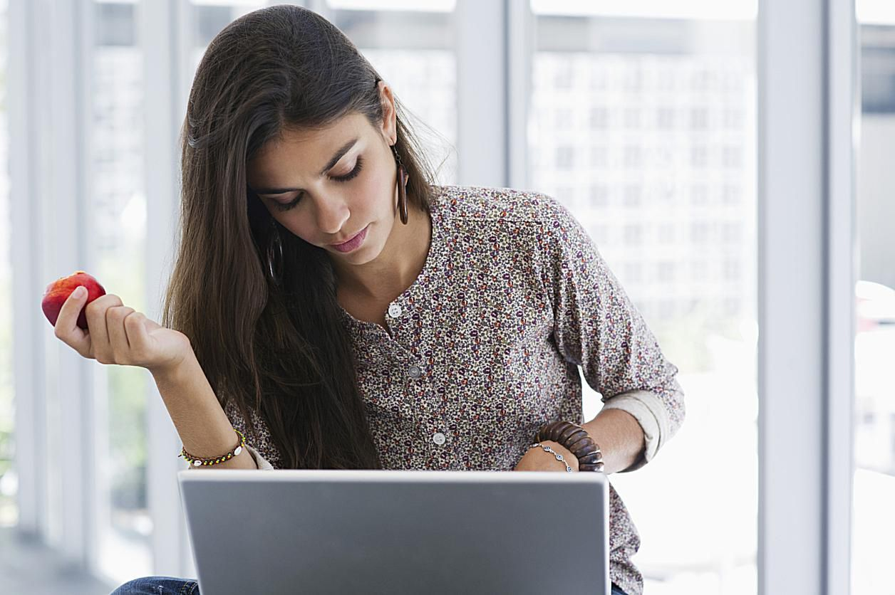 Woman with Laptop and Apple