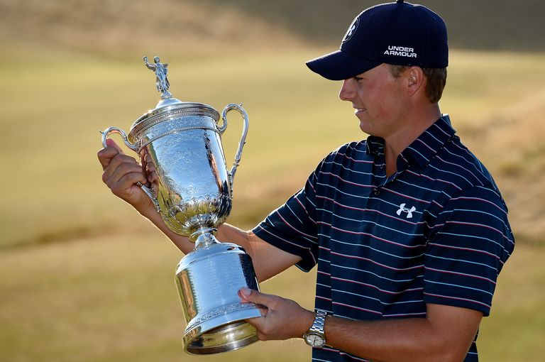 The US Open trophy held by 2015 winner Jordan Spieth
