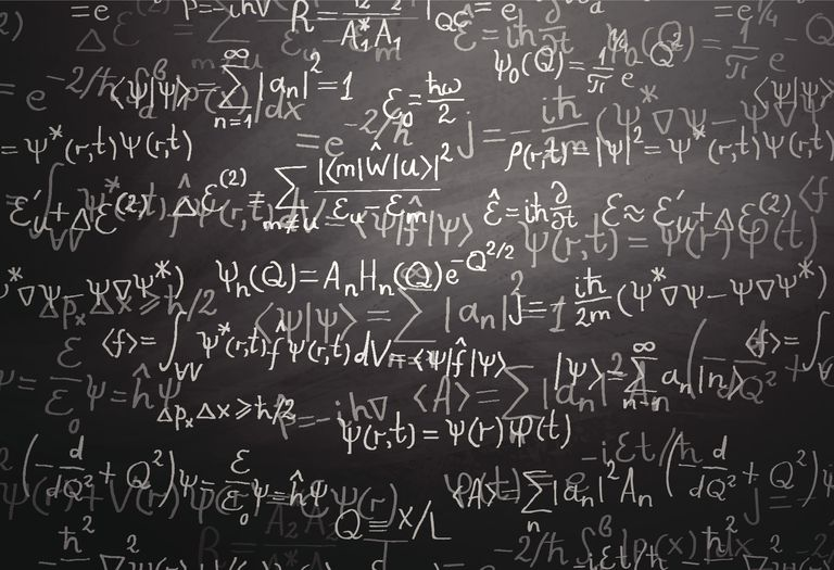 Quantum physics formulas over blackboard
