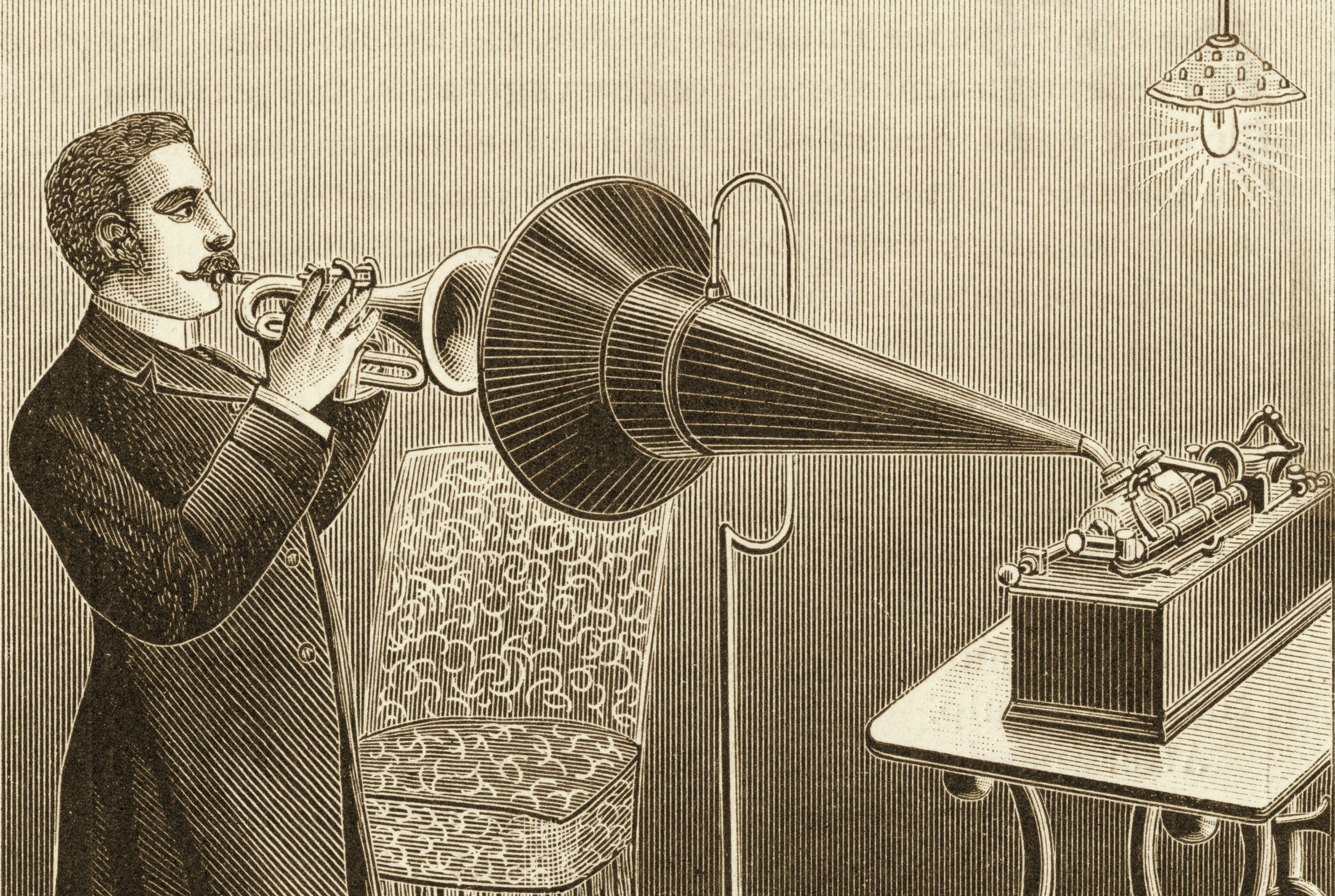 Engraved illustration of corner player being recorded by a phonograph.