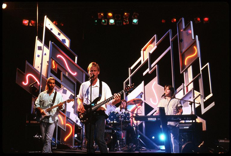 Mr. Mister performs on stage in all its mid-'80s neon glory.