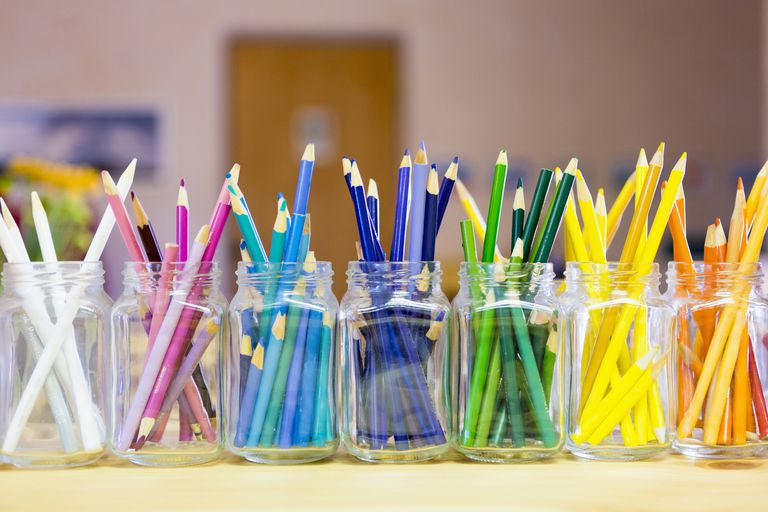 Containers of pencils organized by color