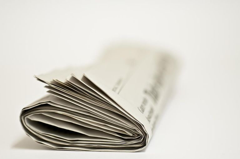 rolled newspaper front view.