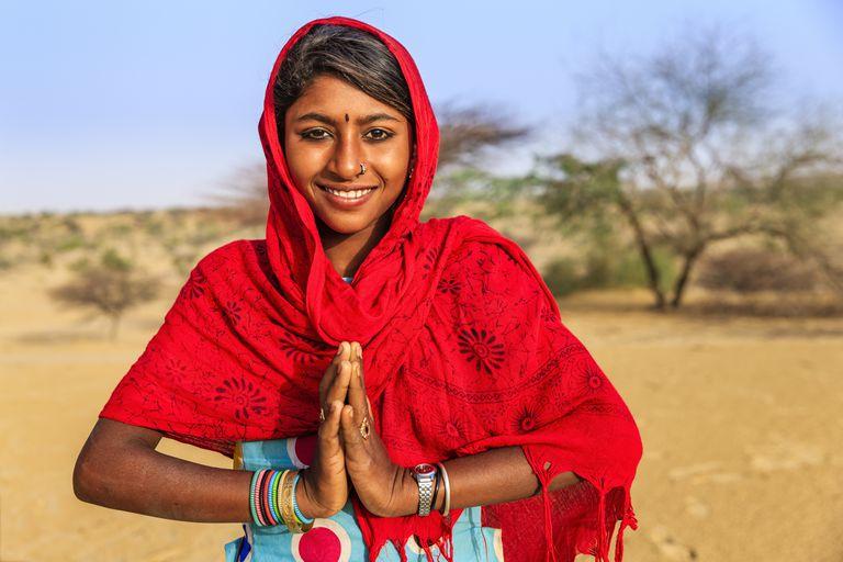 Understanding the true power of namaste namaste portrait of happy indian girl in desert village india m4hsunfo