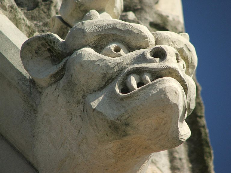 A gargoyle on a cornice