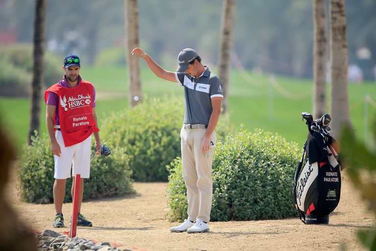 Renato Paratore takes a penalty drop during the 2016 Abu Dhabi HSBC Golf Championship
