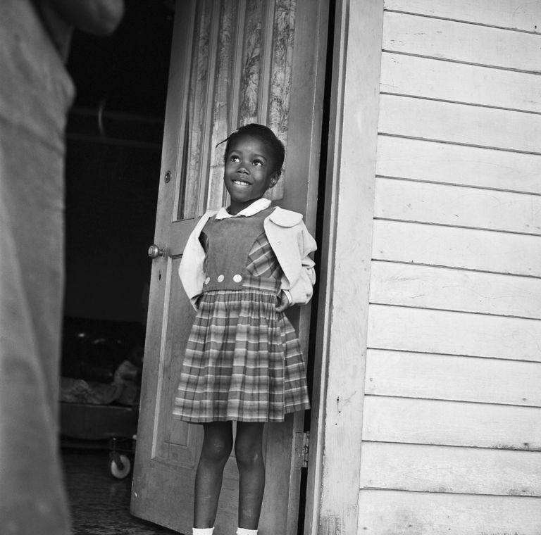 Ruby Nell Bridges next to open door.