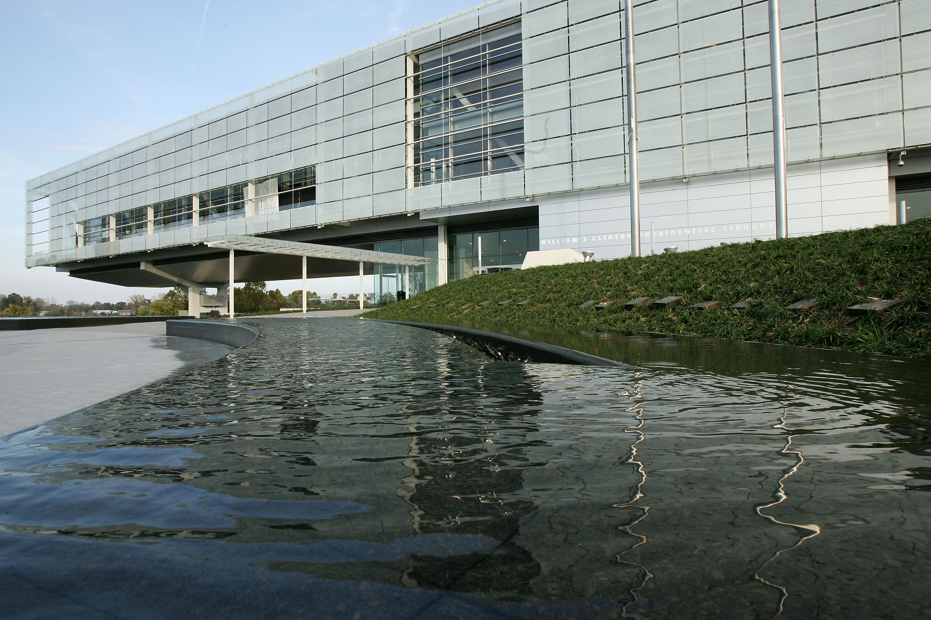 modern building sweeping over a body of water from land
