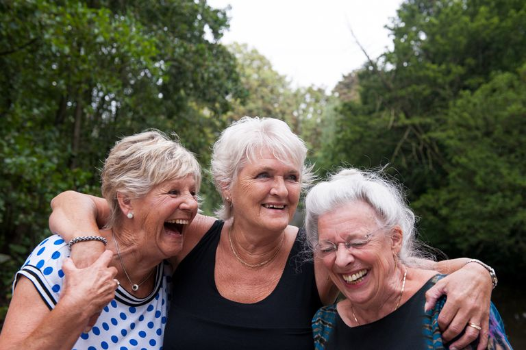 Three senior girlfriends having fun in the park