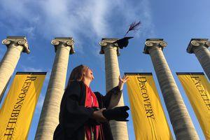 A woman celebrating college graduation