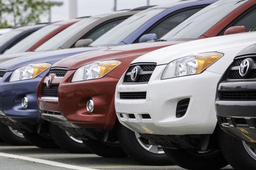 New Toyota Rav4 Vehicles in a Row at Car Dealership