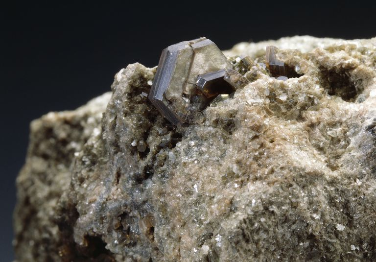 Biotite is a dark form of mica that is found in many rocks.